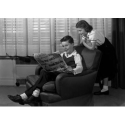 Posterazzi SAL25516393 Boy Reading Comic in Armchair with Girl Peeking Over Shoulder Poster Print - 18 x 24 in.