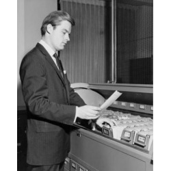 Posterazzi SAL25548214 Side Profile of Businessman Reading Document Beside Filing Cabinet Poster Print - 18 x 24 in.