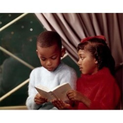 Posterazzi SAL3811362191 Close-Up of a Boy Reading a Book with His Sister Poster Print - 18 x 24 in.