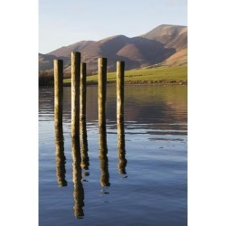 Posterazzi DPI12290116LARGE Wooden Posts Reflected in Tranquil After with Mountains The Background - Keswick Cumbria England Poster Print by John.