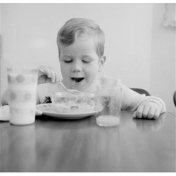 Posterazzi SAL255424935 Boy Eating Breakfast Cereal Poster Print - 18 x 24 in.