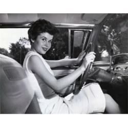 Posterazzi SAL2557877 Young Woman Sitting in the Drivers Seat of a Car & Smiling Poster Print - 18 x 24 in.