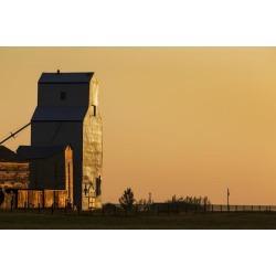 Posterazzi DPI12284619 Wooden Grain Elevator Reflecting The Orange Glow of Sunrise - Mossleigh Alberta Canada Poster Print by Michael Interisano.