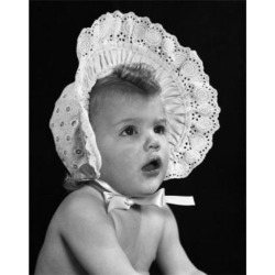 Posterazzi SAL2559476A Close-Up of a Baby Girl Wearing a Bonnet Poster Print - 18 x 24 in.