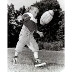 Posterazzi SAL2557745 Boy Kicking a Football Poster Print - 18 x 24 in.