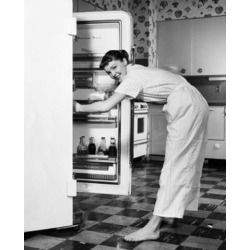 Posterazzi SAL2555355 Side Profile of a Young Woman Standing in Front of a Refrigerator Poster Print - 18 x 24 in.