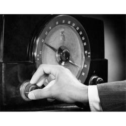 Posterazzi SAL2554593 Man Adjusting the Knob of a Radio Poster Print - 18 x 24 in.