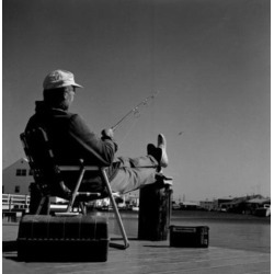 Posterazzi SAL255417827 Fisherman Sitting in Chair at the Edge of Water Poster Print - 18 x 24 in.