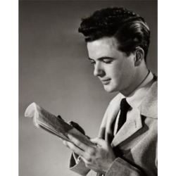 Posterazzi SAL25542673 Side Profile of a Young Man Reading a Newspaper Poster Print - 18 x 24 in.
