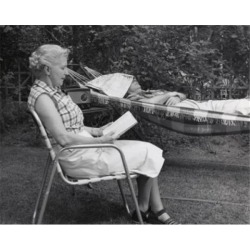 Posterazzi SAL25548928 Side Profile of a Senior Woman Reading a Book with a Senior Man Sleeping in a Hammock Poster Print - 18 x 24 in.