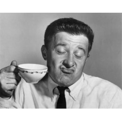 Posterazzi SAL2554250 Mature Man Holding Tea Cup & Making a Face Poster Print - 18 x 24 in.