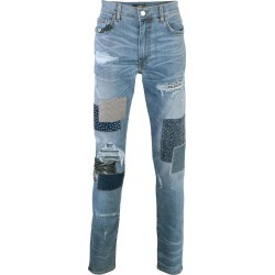 Amiri distressed slim-fit jeans - Blue found on MODAPINS from FARFETCH.COM Australia for USD $1607.56