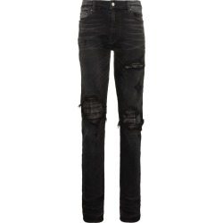 Amiri slim-fit distressed cotton and leather jeans - Black found on MODAPINS from FARFETCH.COM Australia for USD $1298.28