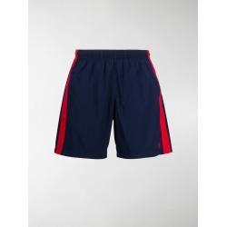 Alexander McQueen side stripe swim shorts found on Bargain Bro UK from MODES GLOBAL