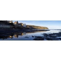 Reflection Of Buildings In Water, Robin Hood's Bay, North Yorkshire, England, United Kingdom Poster Print found on Bargain Bro India from MassGenie for $27.91