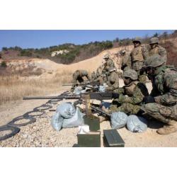 A field wireman fires an M2 50 caliber heavy machine gun Poster Print by Stocktrek Images