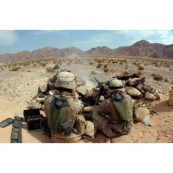A marine fires his M2 50 caliber heavy machine gun Poster Print by Stocktrek Images