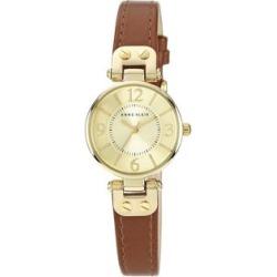 Montre dorée avec bracelet en cuir