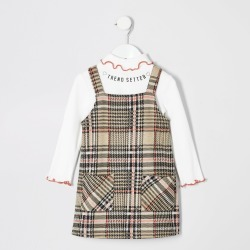 River Island Mini girls check pinafore dress out found on Bargain Bro UK from River Island - UK