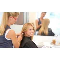 Haircut with Optional Partial or Single Process Color at Glam Dolls Studio (Up to 52% Off)