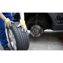 Wheel Alignment or Gift Certificate at IWC Motorsports Tire Pros (Up to 50% Off). Three Options Available.