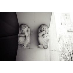 Photographic Print: Depressed and laughing stucco sculptures, historic building entrance, Manhattan, New York, USA by Andrea Lang: 12x8in