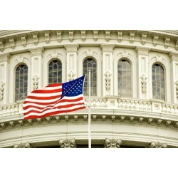 Photographic Print: The Flag of the USA Flying in Front of the Capitol Building in Washington, Dc. by Gary Blakeley: 24x16in