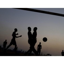 Photographic Print: People Play Soccer at a Camp Set Up for Earthquake Survivors Left Homeless in Port-Au-Prince: 24x18in