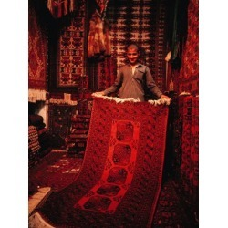 Photographic Print: Carpet Trader Displaying a Woolen Carpet, Peshawar, North-West Frontier Province, Pakistan by Richard I'Anson: 24x18in