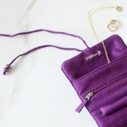 Compact silk travel jewellery roll in candy