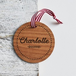 Personalised name with dots border round wooden Christmas decoration