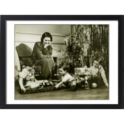 Large Framed Photo. Mother watching three children playing by