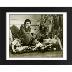 Framed Photo. Mother watching three children playing by