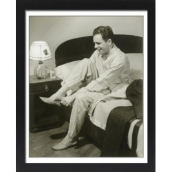 Large Framed Photo. Mature man sitting on bed putting on found on Bargain Bro Philippines from Media Storehouse for $180.45
