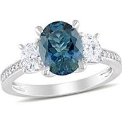 2.5 CT. T.G.W. Blue Topaz and 0.6 CT. T.W. Diamond Three-Stone Engagement Ring in 14k White Gold 9 found on Bargain Bro from Sam's Club for USD $1,063.24