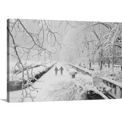 Large Gallery-Wrapped Canvas Wall Art Print 24 x 16 entitled Couple Walking Through Park In Snow