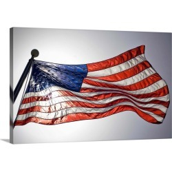 Large Solid-Faced Canvas Print Wall Art Print 30 x 20 entitled The American flag flies prominently