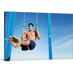 Large Solid-Faced Canvas Print Wall Art Print 30 x 20 entitled Man on a beach working out on exercise rings apparatus