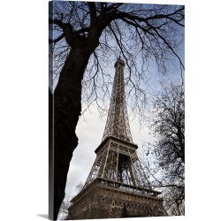 Large Gallery-Wrapped Canvas Wall Art Print 20 x 30 entitled The famous Eiffel Tower framed by trees in Paris, France