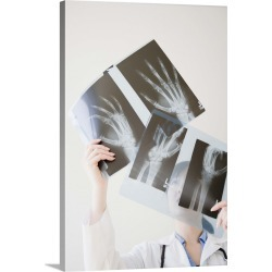 Large Solid-Faced Canvas Print Wall Art Print 20 x 30 entitled Doctor looking at x-rays of hand bones found on Bargain Bro India from Great Big Canvas - Dynamic for $169.99