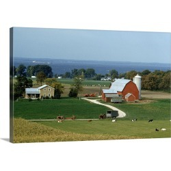 Large Gallery-Wrapped Canvas Wall Art Print 24 x 16 entitled Dairy farms with tractors and cows line the shore of a windy bay found on Bargain Bro India from Great Big Canvas - Dynamic for $224.99