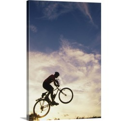Large Gallery-Wrapped Canvas Wall Art Print 16 x 24 entitled Silhouette of man in mid-air on mountain bike