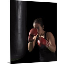 Large Solid-Faced Canvas Print Wall Art Print 24 x 30 entitled Boxer training on punching bag