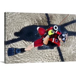 Large Solid-Faced Canvas Print Wall Art Print 30 x 20 entitled A rescue swimmer gets hoisted into an MH-60 Jayhawk helicopter