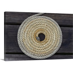Large Gallery-Wrapped Canvas Wall Art Print 24 x 16 entitled A boat rope coiled in a pattern to avoid tangling
