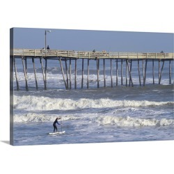 Large Gallery-Wrapped Canvas Wall Art Print 24 x 16 entitled A Boy paddles out into big waves on his standup paddle board ... found on Bargain Bro India from Great Big Canvas - Dynamic for $224.99