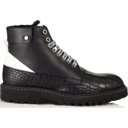 The Voyager: SNOW/M Black Vachetta Leather Ankle Boots with Heated Soles found on MODAPINS from Jimmy Choo for USD $1895.00