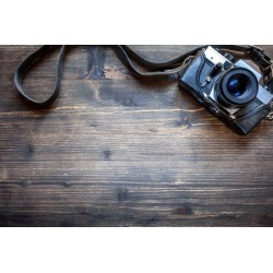 "Old Retro Camera On Wooden Table Background Wallpaper Mural by Limitless Walls | Small 5'5"" W x 4'3"" H 