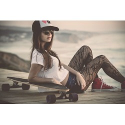 """Girl With Skateboard Wallpaper Mural by Limitless Walls 
