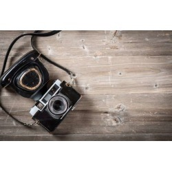 "Retro Camera On Wooden Table Wallpaper Mural by Limitless Walls | Small 5'5"" W x 4'3"" H 